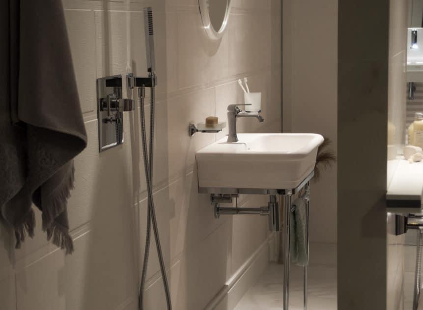 white floating sink in bathroom